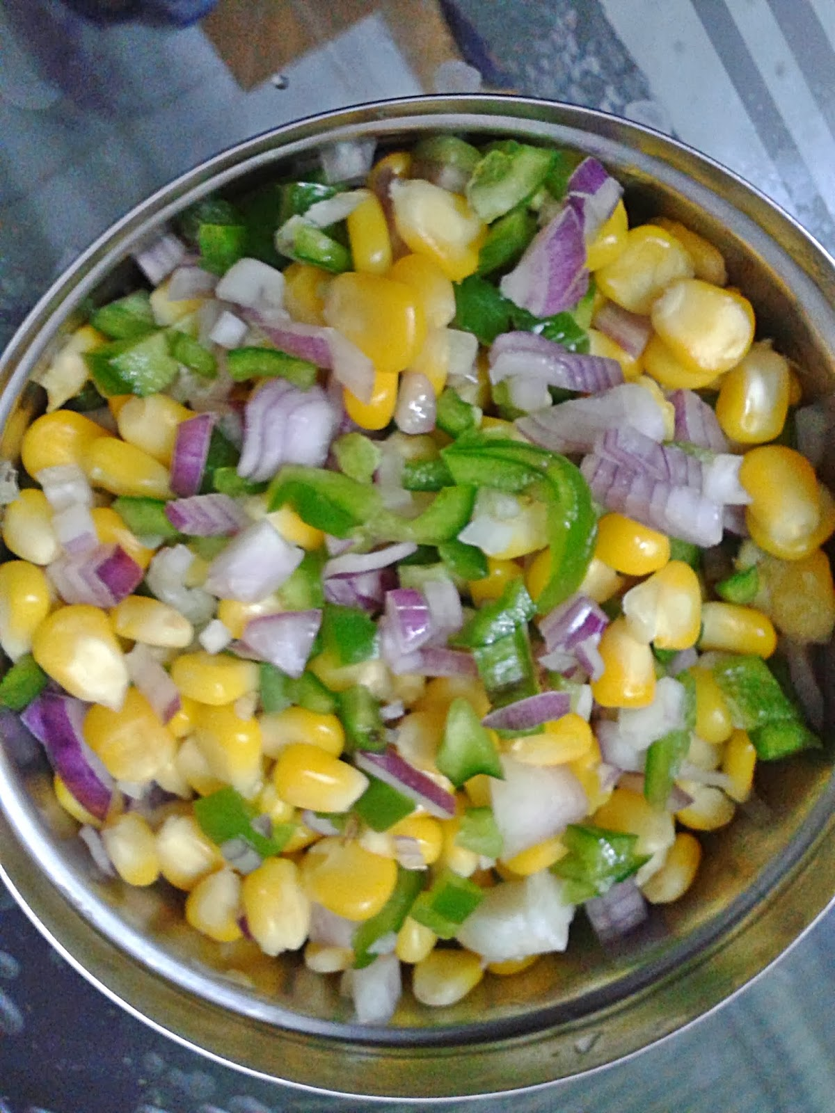 Chop all the vegetables and mix them in a mixing bowl.