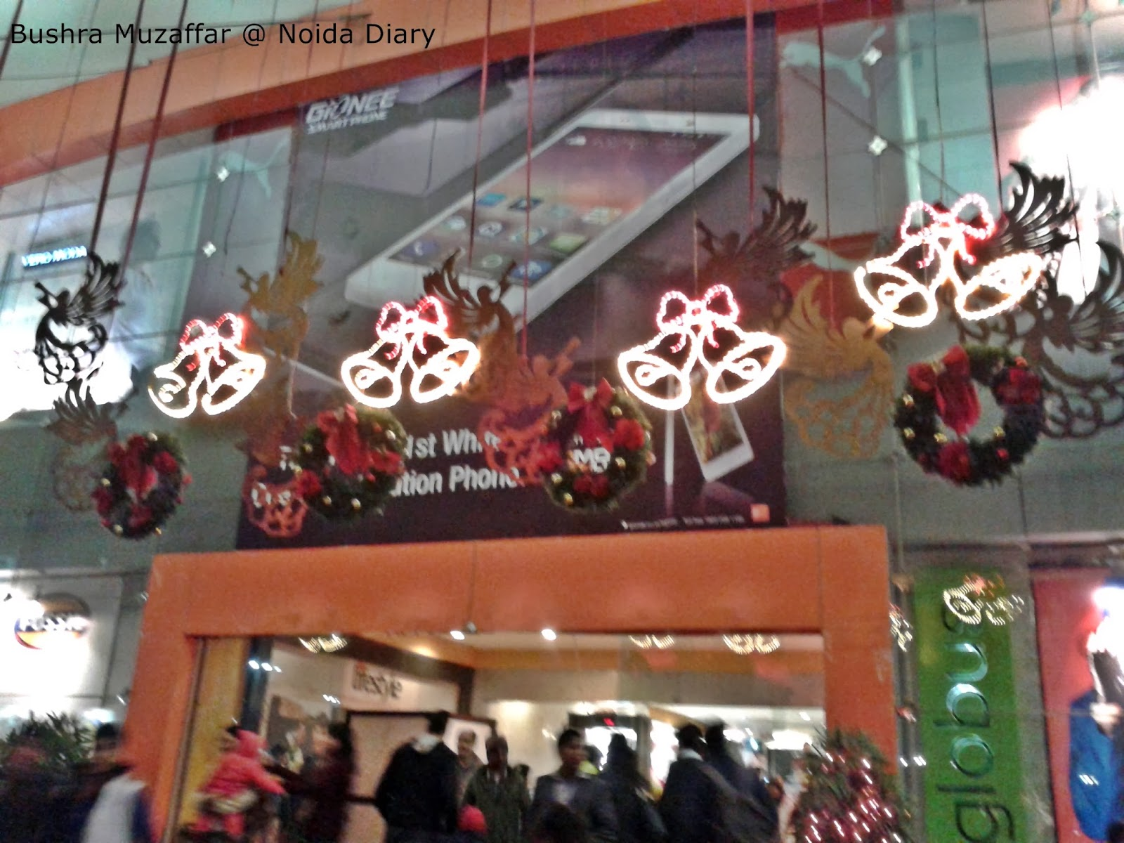 Entrance of the TGIP Mall decorated in red and greens for Christmas