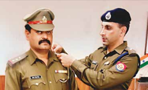SSP Dr Preetinder Singh adding stars to the newly decorated Inspector Samarjeet Singh