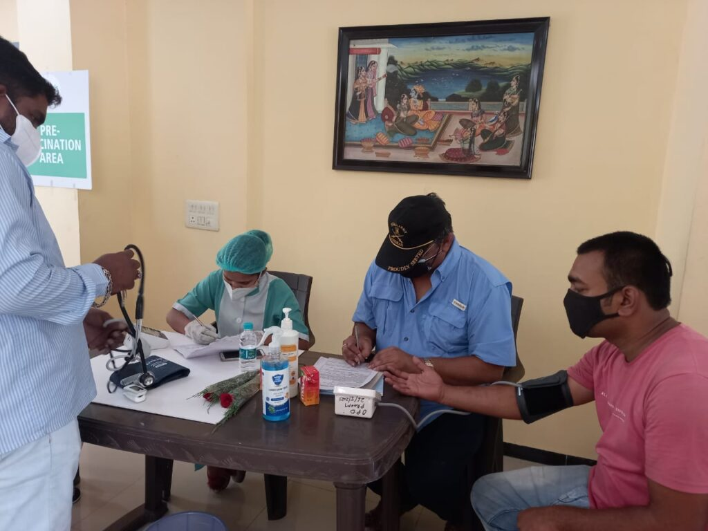 Noida Diary : Brig Bhatt, President, RWA sector 31 A block  helping with blood pressure checks of the residents prior to getting vaccinated